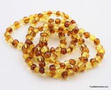 Bicolor Baltic amber elastic adult bracelets