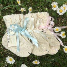Newborn knitted socks in organic cotton