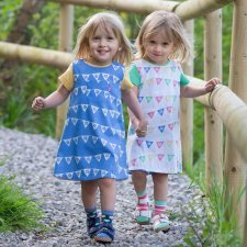 Reversible pinafore dress in organic cotton